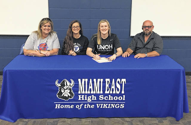 Photo Provided Miami East High School senior Haley Howard recently signed her letter of intent to play basketball for UNOH in Lima. From the left are her mother Nicole, sister Nikki, Howard and her father Earn.