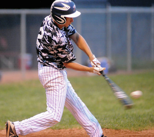 Cory Cotrell makes contact for Piqua Post 184 during Sunday's championship game at Hardman Field.