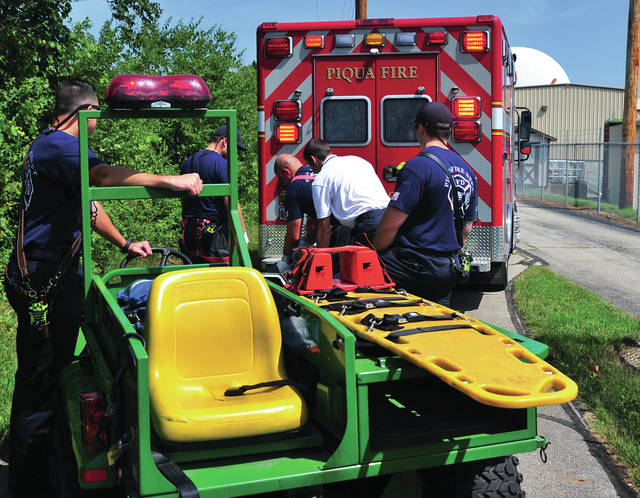 Mike Ullery | Daily Call Piqua medics tend to patient found on the bike path south of Piqua on Tuesday morning. The male was reportedly dehydrated and disoriented when he was found by a passing bicyclist.