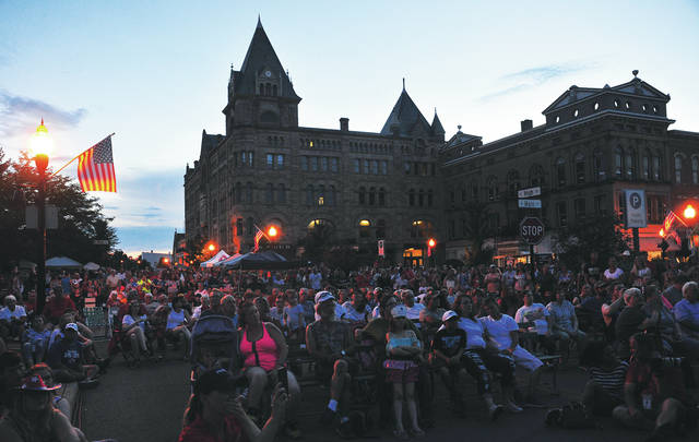 Mike Ullery | Daily Call A large crowd gathered in downtown Piqua to watch hometown singing duo <em>Reflektion</em> wrap up 4th Fest on Wednesday. Immediately following <em>Reflektion&#8217;s</em> performance was the debut of the new music video This Small Town Piqua.