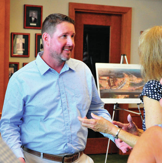 Mike Ullery | Daily Call Outgoing assistant city manager for the City of Piqua Justin Sommer, chats with Miami Valley Centre Mall manager Peggy Henthorne during an open house for Sommer at the Piqua City Building on Friday.