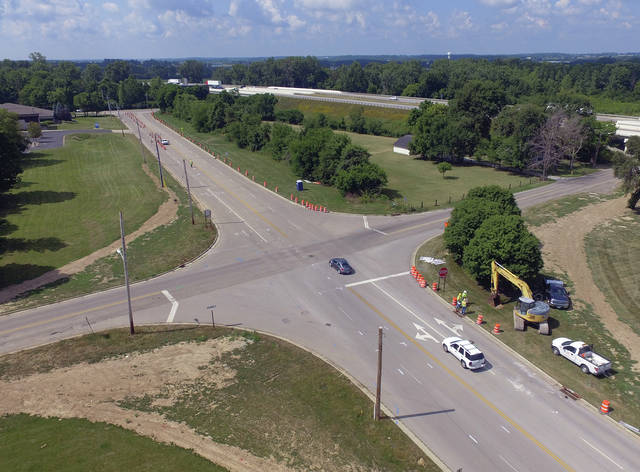 Mike Ullery | Daily Call Construction equipment and orange barrels have begun to arrive at the intersection of Looney and Garbry Road where a roundabout will be built to replace the existing four-way stop. Completion of the project is expected sometime in August. Signs for designated detour routes are in place.