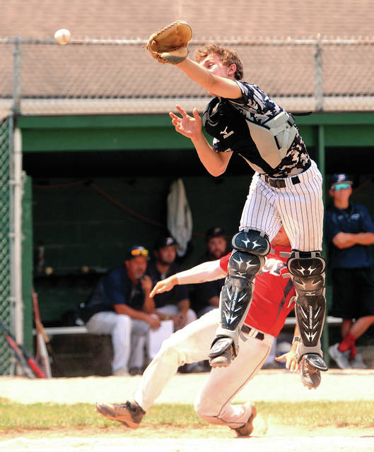 Piqua Post 184 catcher Howie Ludwig makes a leaping attempt at an errant throw to home.