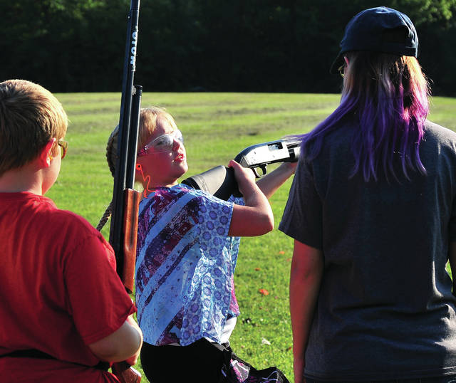 Mike Ullery | Daily Call Addison Dansford, 9, of Troy calls for her bird at the Piqua Fish & Game Club trap range on Wednesday evening during a 4-H Club meeting at the range. Dansford is a member of the Miami County Trap Shooters 4-H Club, the oldest shooting club in Miami County.