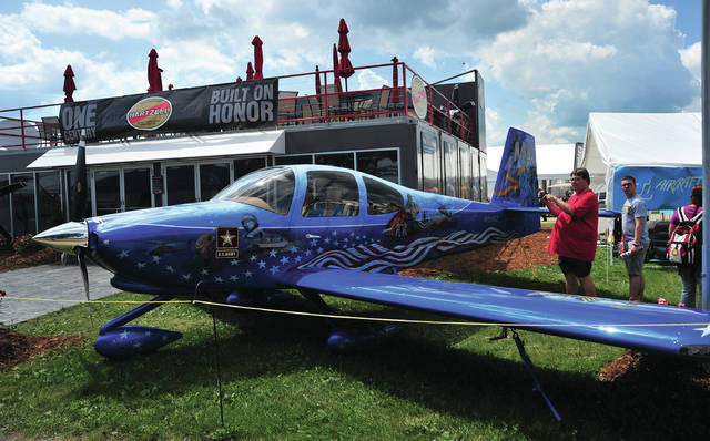 Mike Ullery | Daily Call AirVenture 2018 visitors check out an RV-10 aircraft wrapped to honor our nation&#8217;s military history over the weekend in front of the Hartzell Propeller building at Oshkosh, Wisconsin. The aircraft, named <em>Liberty </em>and owned by Rodney Jarell, was on display, proudly bearing a Hartzell propeller, for the entire week at the annual Experimental Aircraft Association convention, where Piqua-based Hartzell is one of the premier participants. Visitors from around the world attend the annual event.