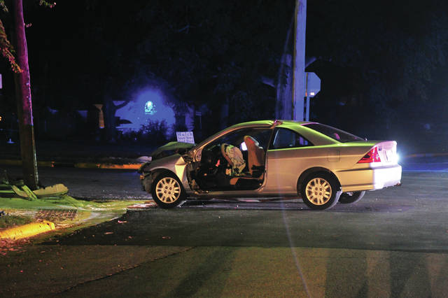 Mike Ullery | Daily Call A vehicle sits in the roadway at Hayes and Jay streets in West Milton following a fatal car crash on Monday evening.