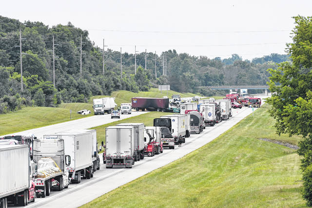 Traffic was backed up for miles Thursday afternoon following a multi-vehicle crash on Interstate 75 just north of Sidney. At least one person was killed in the crash.
