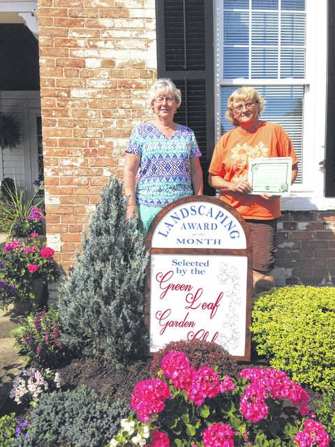"Provided photo The Piqua Green Leaf Garden Club presented their July Landscape Award recently to Rick and Connie Maggert of 351 Riverside Drive, Piqua. The award was presented by Judy Quinter, president, and Cheryl Sanders, committee chair, who said Connie was ""too shy"" to be photographed and Rick would not take any credit for the beautifully landscaped home. The Maggerts are long time residents of Piqua and each year, their yard explodes with colorful blossoms."
