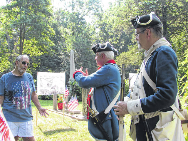 Sam Wildow | Daily Call Doug Redd, left, a descendant of Revolutionary War soldier Lewis Boyer, talks with Terry Whetstone, center, and Paul Schenck, both members and past presidents of the George Rogers Clark Chapter of the Sons of the American Revolution.