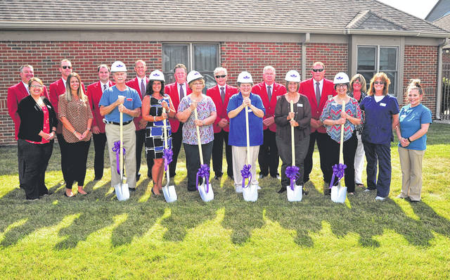 Mike Ullery | Daily Call Garbry Ridge employees including Executive Director Debbie Atkins and Business Development Coordinator Stacy Martin break ground on the planned addition to its existing facility, along with Piqua Area Chamber of Commerce ambassadors and Chamber President Kathy Sherman.
