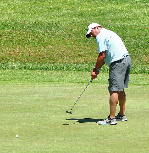 Rob Kiser/Call Photo Brian Deal watches a putt on the 18th green at Piqua Country Club Sunday.