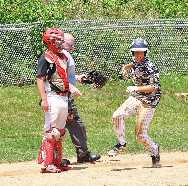 Rob Kiser/Call Photo Cory Cotrell crosses the plate with one of Piqua Post 184's 10 runs Sunday against Van Wert.