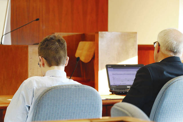 Donovan Nicholas, left, sits with Attorney Darrell Heckman on Wednesday evening after a jury found him guilty of aggravated murder and murder. A sentencing hearing is scheduled for Tuesday.