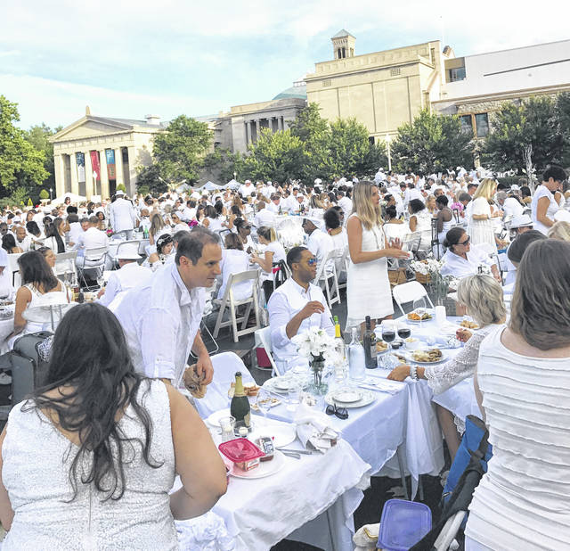 """Provided photo Guests enjoy """"diner en blanc"""" — """"dinner in white"""" — at a picnic party attended in Cincinnati by Tom Westfall, who is organizing a similar event in Piqua, to be held on Sunday, Sept. 2, at the Orrmont Estate."""