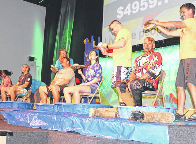 Provided photo During the Penny Wars held as part of the Valley Church's recent Vacation Bible Adventure, volunteers from the losing side were slimed and soaked on stage each night.