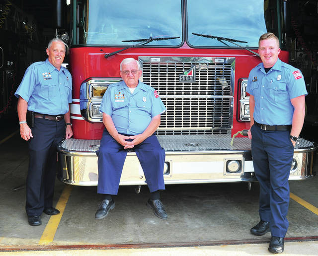 Mike Ullery | AIM Media Midwest Ken Putnam, his father-in-law Stephen Stocker, and his son Keagen Putnam, are all active members of the Tipp City Fire Department.