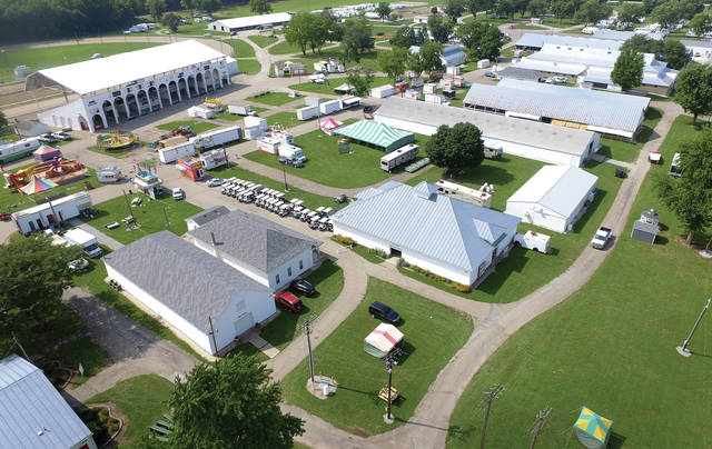 Mike Ullery | Daily Call Move-in is in high gear as vendors and fair officials prepare for Friday's opening of the 2018 Miami County Fair.