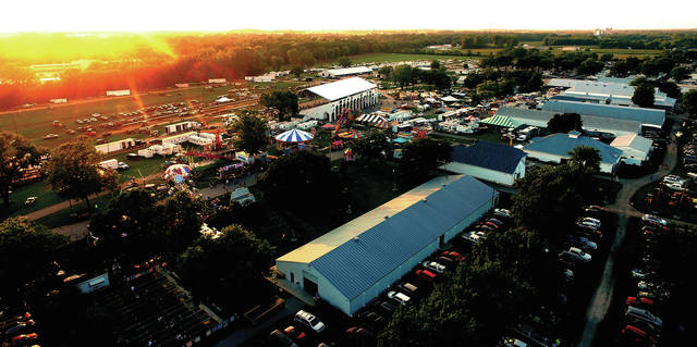 The sun sets on Saturday evening at the Miami County Fair.