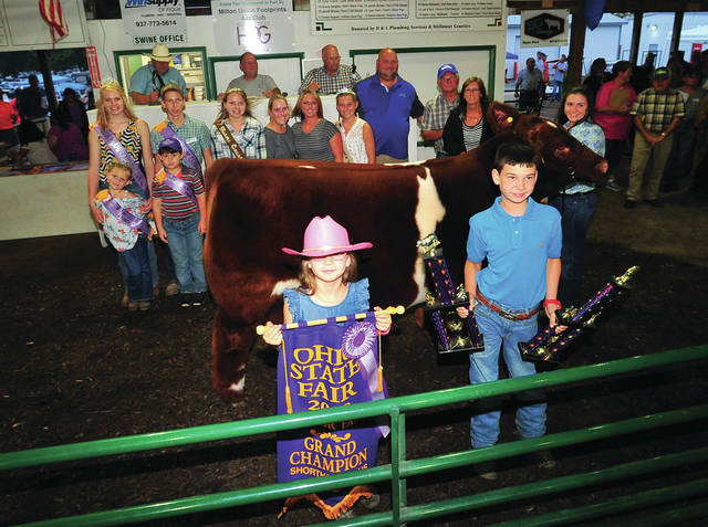 Kassidy Thompson, of Troy, Grand Champion Market Steer, was purchased for $12,500. She is the daughter of Dave and Tammy Thompson. The buyers were Kenny and Jenni Kirby of Fletcher and Dale Stager of Select Arc.