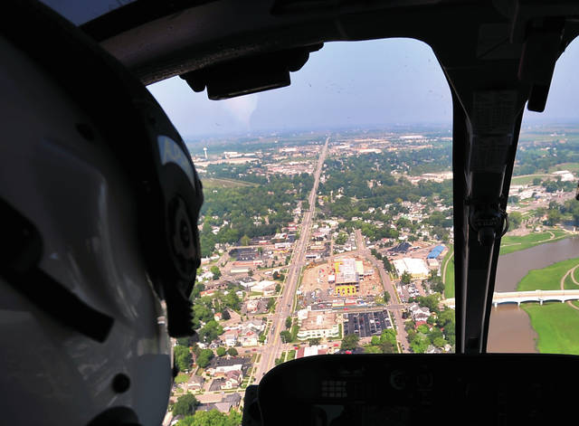 Mike Ullery | Daily Call MedFlight Pilot Dave Pratt checks out the Kettering Hospital Troy location as he circles the new facility on Wednesday.
