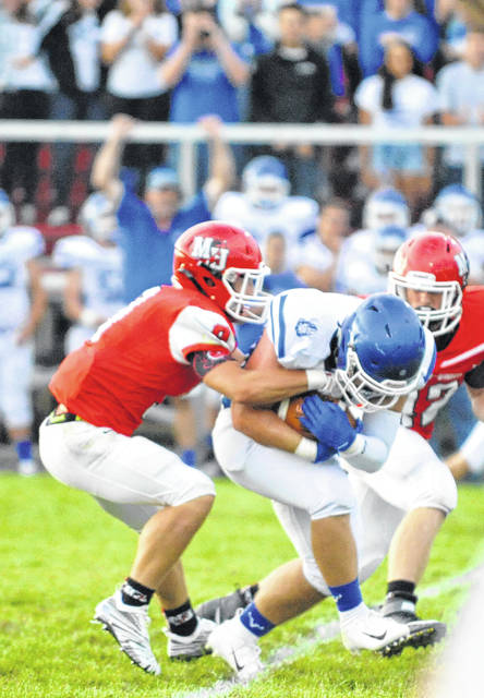 Josh Brown/Troy Daily News Miami East's Colt Frazier intercepts a Milton-Union pass Friday.