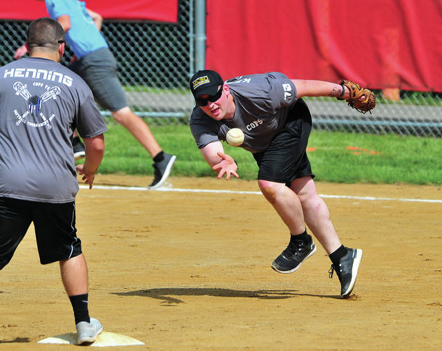 Shortstop Mike Marion from the Miami County Sheriff's Office scoops the ball to second baseman, Corrections Officer Codie Henning, for a force at second during Friday's softball game pitting kids from the West Central Rehabilitation Center against deputies and corrections officers. The game was the brainchild of West Central Executive Director Brent Knackstedt, who not only organized the games but designed the uniform shirts. The games allowed both the youth and the officers to see a more human side of each other and have some fun at the same time.