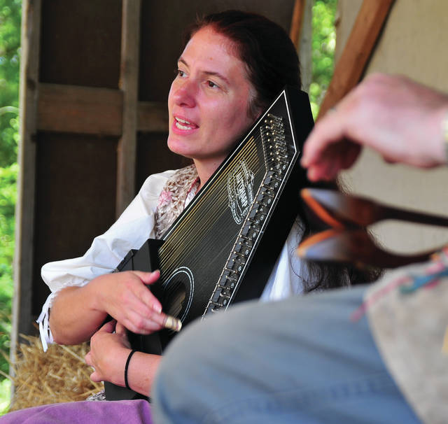 Mike Ullery | AIM Media file photo Bettina Solas performs on the dulcimer, accompanied by a spoons player at the 2017 Fort Rowdy Gathering in Covington Community Park.