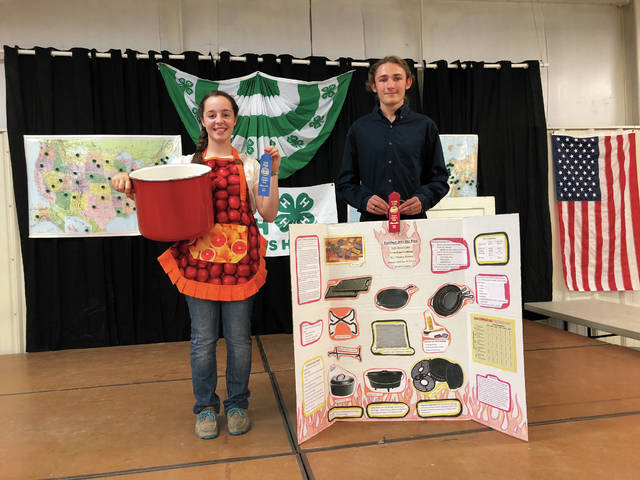 From left, first place Emma Sutherly, second place Thomas Burkett in the Senior Division Miscellaneous Revue. Sutherly did a project about canning produce. Burkett did a project centered around grilling.