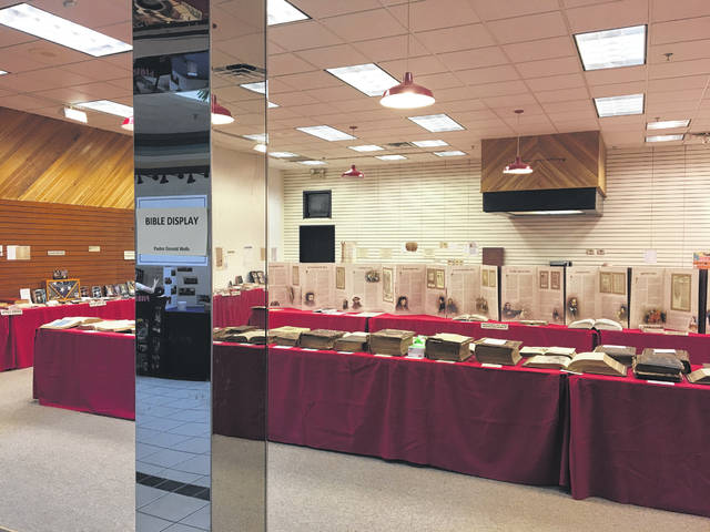 Sam Wildow | Daily Call The antique Bible collection of Don Wells, a former Piqua resident and pastor, was on display in the Miami Valley Centre Mall during the Piqua Association of Churches' annual church fair over the weekend.