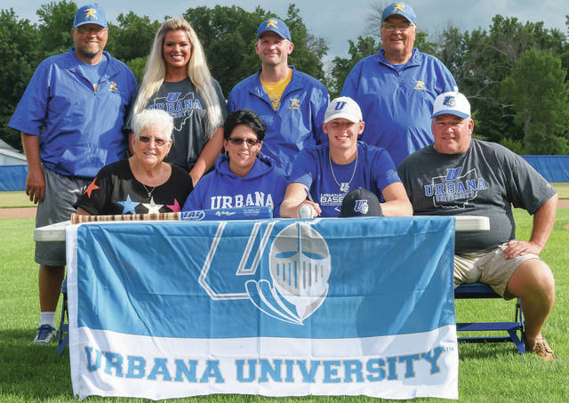 Bryant Billing/Aim Media Photo Hunter Cohee, second from bottom right, poses with family and Russia coaches after signing to play baseball at Urbana University on Monday at Russia Community Park. Cohee had a 6-1 record and 0.80 ERA last season.