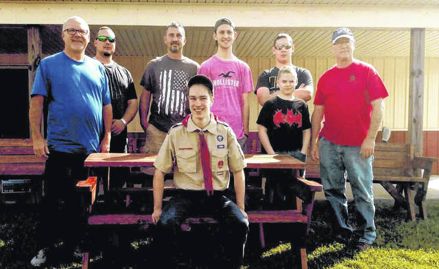 Provided photo Left to right, Pastor William Halter, Scout Leader Jeremy Folsom, Assistant Scout Leader Roger Miller II, Roger Miller III, Austin Folsom, Kyle Folsom, Bark Klepinger, and Will Klepinger (in uniform) with picnic tables created for Lockington United Methodist Church.