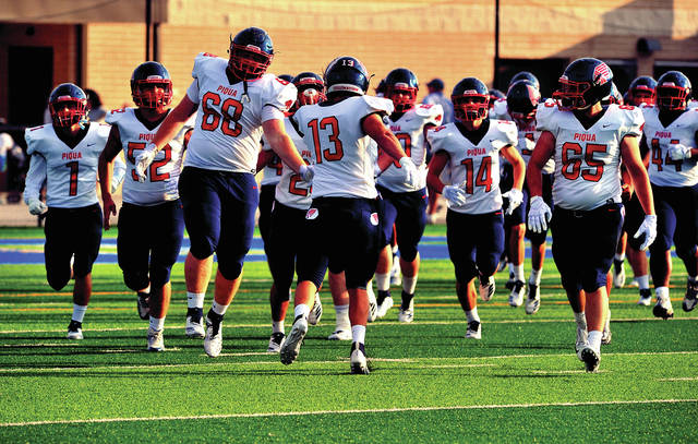 The 2018 Piqua Indians football team takes the field at C-J on Friday.