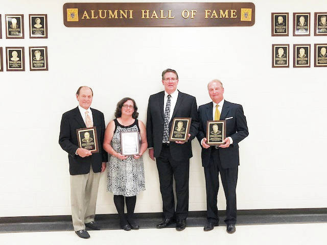 Provided photo The Lehman Catholic High School Alumni Association inducted five new members to the Lehman Catholic Hall of Fame during a ceremony on Aug. 4. Left to right, are Benjamin P. Scott Sr.; Jill Burden, daughter of the late Lester and Marilyn Kloeker; Thomas J. Frantz; and William R. Zimmerman Sr.