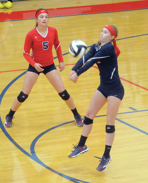 Piqua's Kamy Trissel passes the ball against Sidney on Tuesday as Reagan Toopes looks on.