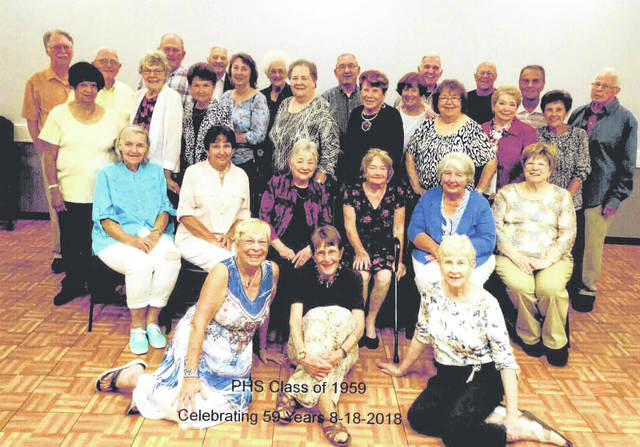 Provided photo Piqua High School Class of 1959 celebrated their 59th class reunion on Aug. 18. Shown above, left to right, are: first row — Joanne Mong Allison, Jane Ruble Scocca, Carol Thompson Hornyak; second row — Sandy Ostendorf Abernathy, Beverly Heisler Konz, Judy Pool Krasnoff, Walda Gard Reeves, Cathie Morgan Dally, Shirley Supinger Norris; third row — Sarah Burns Clark, Barbara Kiser Aldredge, Joy Petty Heisler, Joanne Benkert Townsend, Kay Penrod, Sally Copsey Apple, Sandy Wagner Miller, Terri Perkins Shampton, Carolyn McVety Burns; fourth row — Robert Scheer, Bruce Hogston, Don Woods, Don Bowdle, Sara Houser Foust, Nick Brookhart, Jackie Motter Honeycutt, Gary Stanton, Tim Townsend, Robert Burns, Mike Vosler.