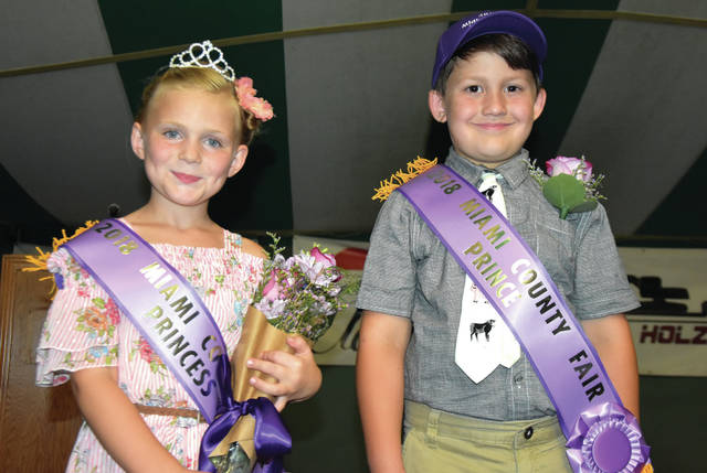 Cody Willoughby | Troy Daily News Miami County residents Natalie Parke and Kael Black stand together after being crowned the 2018 Miami County Fair Prince and Princess on Friday at the fairgrounds. The fair, which opened on Friday, is set to continue through Thursday, Aug. 16.