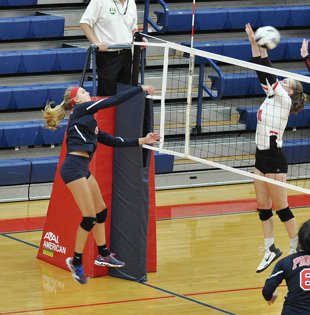 Rob Kiser/Call Photo Piqua's Haleigh Beougher hits through a Tippecanoe block Thursday at Garbry Gymnasium.
