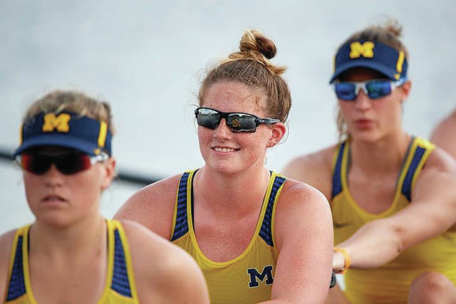 Provided Photo Troy Christian High School graduate Megan Hinkle, center, will be a sophomore on the University of Michigan women's rowing team this year.