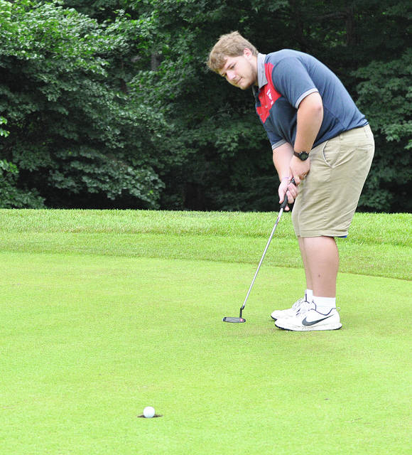 Rob Kiser/Call Photo Piqua's Kyler Kommer roles in a putt on the 10th green Wednesday at Echo Hills.