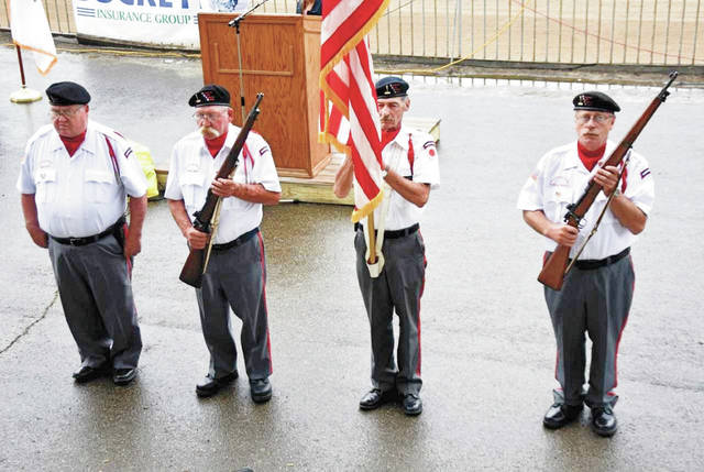 Cody Willoughby | AIM Media Midwest Honor guard members present the flag during the salute to veterans on Wednesday at the 2018 Miami County Fair.