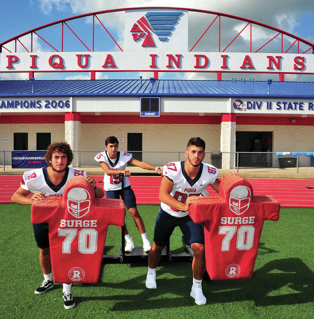 Mike Ullery | Daily Call Cousins Brennan Toopes (89) Owen Toopes (15) and Grant Toopes (87), keep it all in the family as part of the 2018 Piqua Indians football team.