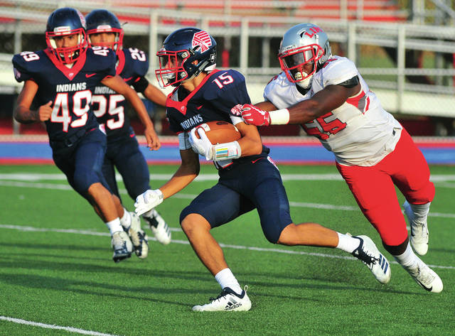 Mike Ullery/Call File Photo Piqua's Owen Toopes returns a kickoff as teammates Trenton Foster (49) and Ca'ron Coleman (25) trail the play.