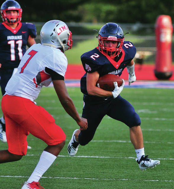 Mike Ullery/Call Photo Colin Roe and the Piqua running game got untracked Friday night against Lima Senior.
