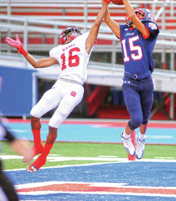 Mike Ullery/Call File Photo Piqua receiver Owen Toopes goes up for a ball against Trotwood-Madison last year.