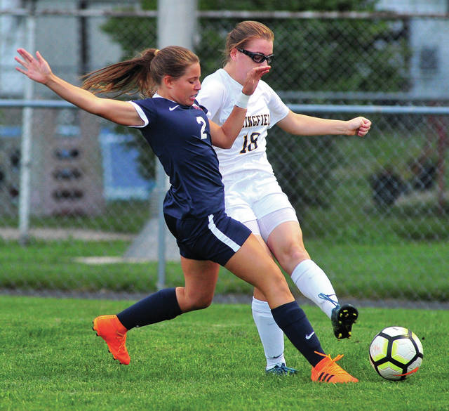 Piqua's Madison McMaken battles for the ball against Springfield Wednesday.