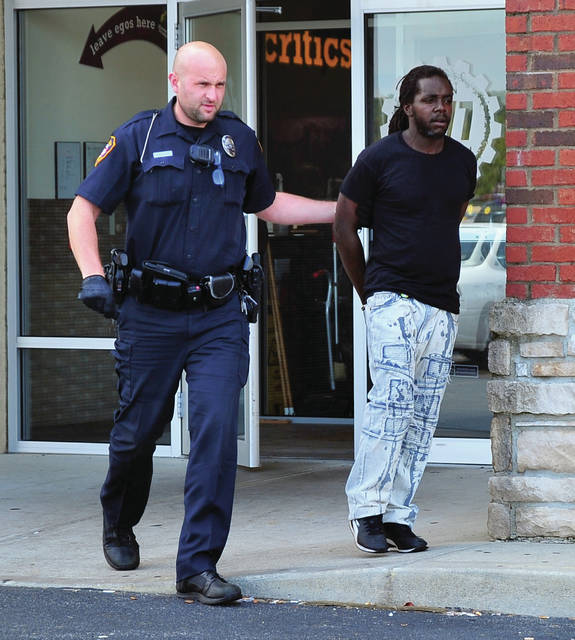 Officer Devon Alexander of the Piqua Police Department leads Darien Anderson, 36, of Dayton, out of the Piqua Planet Fitness on Thursday after Anderson was allegedly witnessed stealing a small refrigerator from the Piqua Walmart. Anderson fled the scene on foot but was quickly apprehended. He was charged with one count of theft and also found to have an arrest warrant out of Montgomery Co. He was taken to the Miami County Jail. The case remains open as officers investigate the possible involvement of a second suspect.