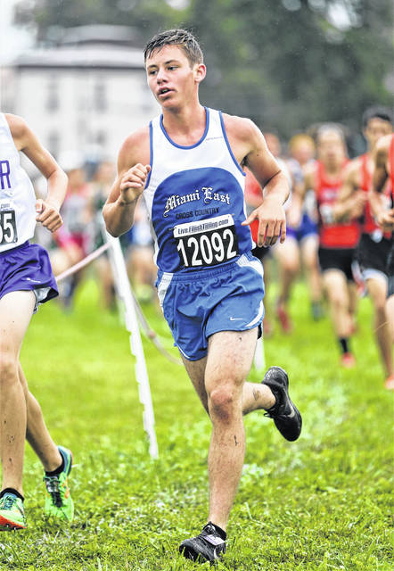 Lee Woolery Photo Miami East's Alex Hayes runs at the Troy Invitational Saturday.