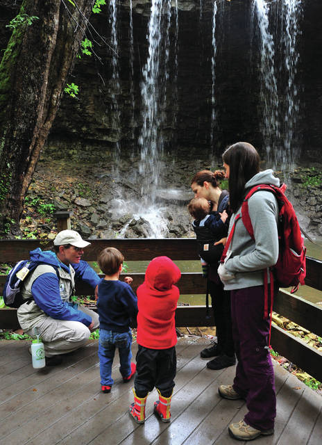 """Miami County Park District Naturalist """"Sassafras"""" Susan Condy, far left, talks to kids about nature during Monday's Trailing Moms and Tots hike at Charleston Falls. Conde is the park district School Education Program Coordinator."""