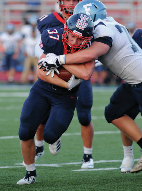 Amanda Ullery | for the Daily Call  Piqua's Makeegen Kuhn, runs for a Piqua touchdown.