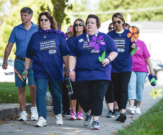 Trisha Elliott, front right, along with her husband, are this years co-chairs of the Miami County Walk to End Alzheimer's, in honor of